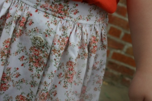 Orange floral skirt placket detail