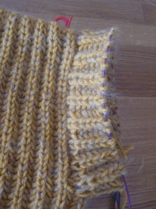 Sleeve detail of lavender jacket in blue, in yellow